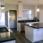 A full shot of a kitchen remodel featuring a peninsula