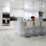 Image of a complete kitchen remodel with all white cabinets and kitchen island