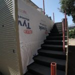 Exterior of the staircase at the back of the garage during construction